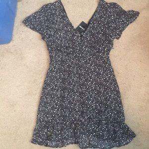 Ruched black and white print ruffled mini dress